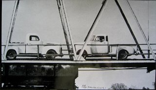 Two Trucks/Two Decisions, by John Baldessari