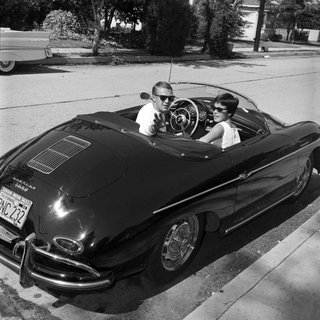 Steve McQueen in his Porsche with wife N. Adams art for sale