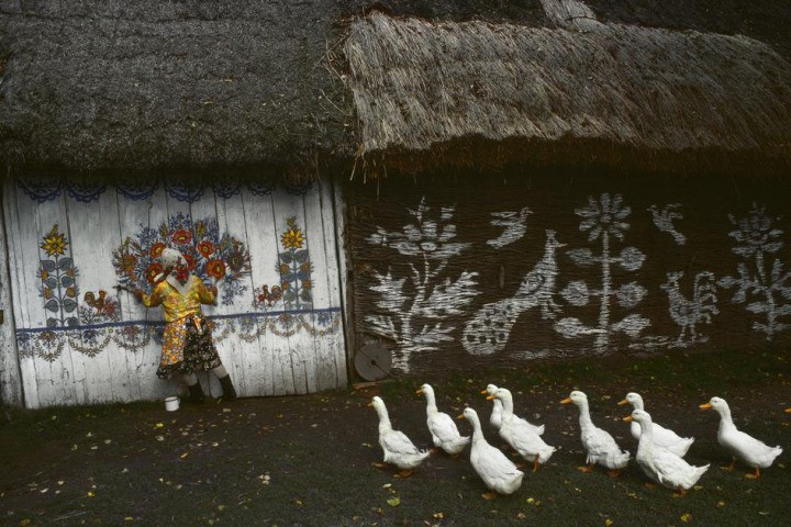 "Bruno Barbey, Poland. Zalipie, the ""painted village"" near Ternow. Houses are completely painted on the inside and outside by their owners. 1976."