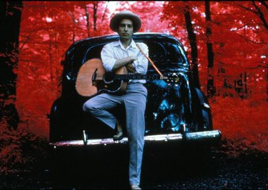 Elliott Landy - Bob Dylan, outside his Byrdcliffe home, infrared color film, Woodstock, NY, 1968.