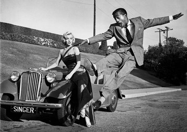 "Frank Worth - Sammy Davis, Jr. leaps for Marilyn Monroe on set of ""How to Marry a Millionaire"""