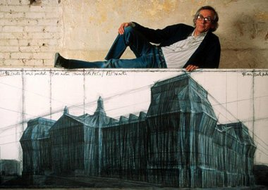 Thomas Hoepker - New York City. 1993. The artist Christo with a drawing for his Berlin Reichstag project in his Manhattan studio.