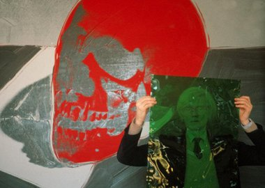 "Thomas Hoepker - New York City. 1981. Andy Warhol with a skull painting in his ""Factory"" at Union Square."