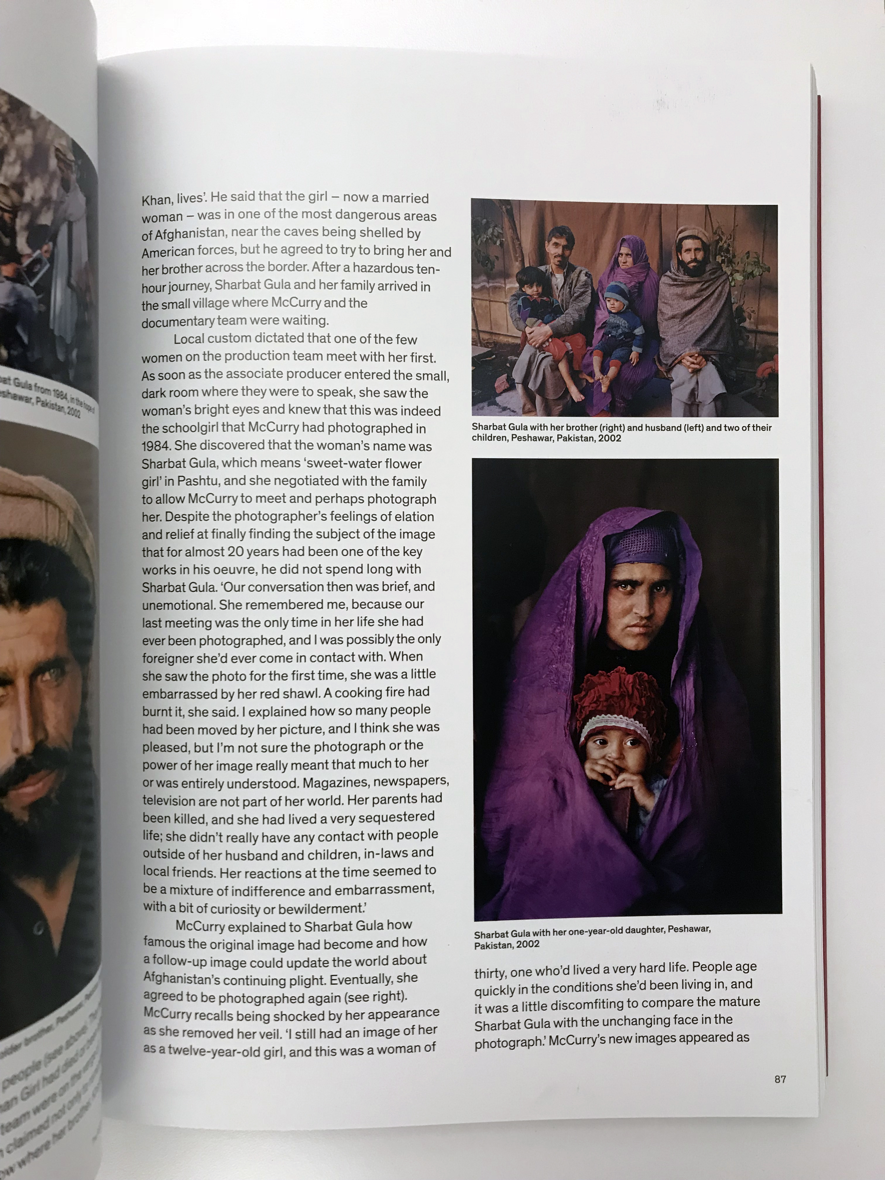 A look inside Steve McCurry Untold, showing the 2002 portrait of Sharbat  Gula with her child.