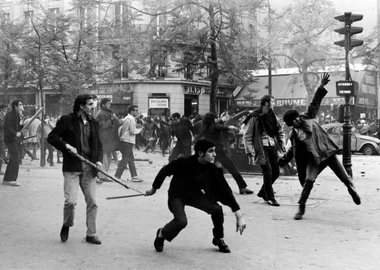 Bruno Barbey - France. Paris. 6th arrondissement. Boulevard Saint Germain. May 6th 1968. Students hurling projectiles against the police.