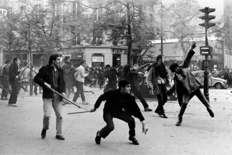 Bruno Barbey, France. Paris. 6th arrondissement. Boulevard Saint Germain. May 6th 1968. Students hurling projectiles against the police.