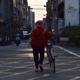 Photograph Print on Handmade Paper - Man Walking Bike in Taiwan art for sale