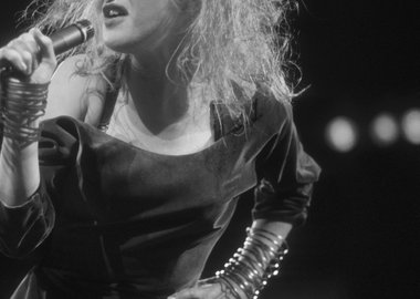 work by David Plastik - Cyndi Lauper Singing on Stage, Hair Blown Back