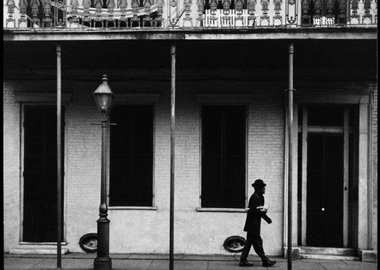 Dennis Stock - USA. New Orleans, Louisiana. 1958. Ernest Miller nicknamed Kid Punch Miller trumpet player and singer returning home at 6 am.