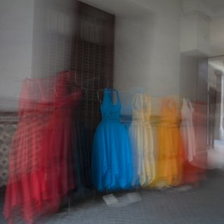 """Colorful Dresses in Mexican Courtyard"" art for sale"