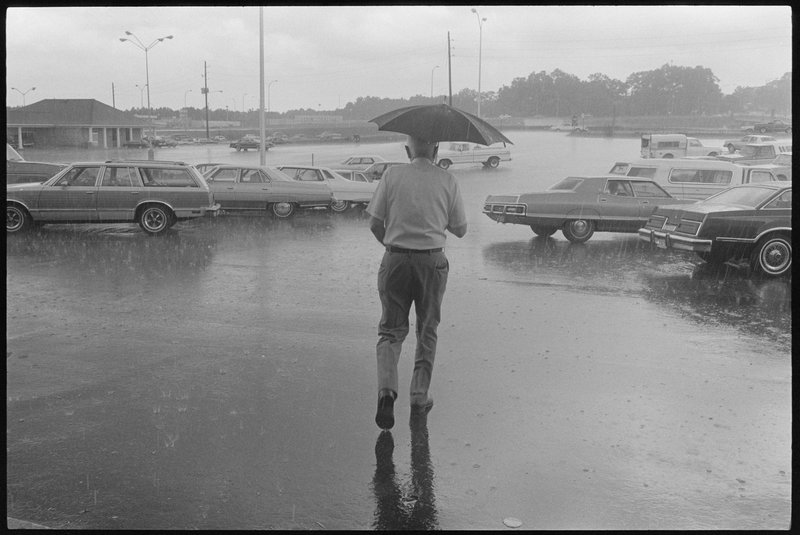 "by richard-johnson - ""Man with Umbrella in Parking Lot"""