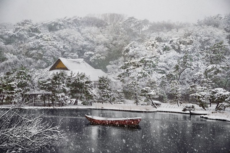 by steve_mccurry - Boat Covered in Snow in Sankei-en Gardens