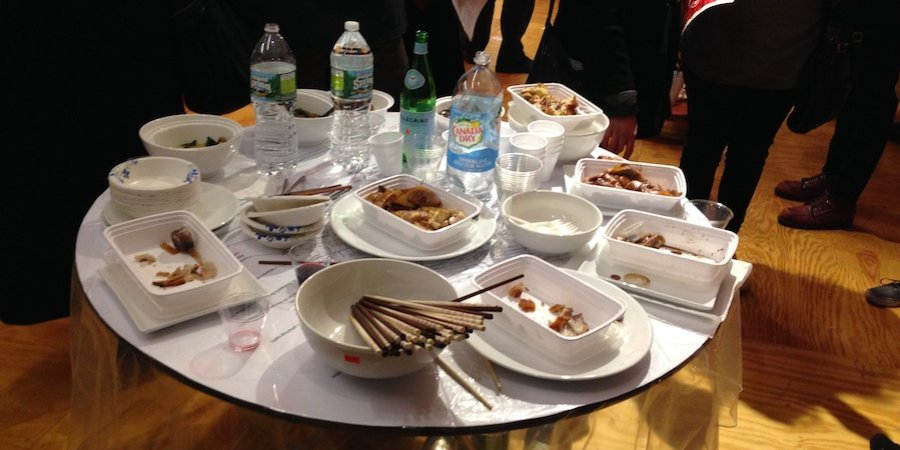 Kwok filled a table with Chinese takeout, telling visitors that if they at the food, they consumed his art.