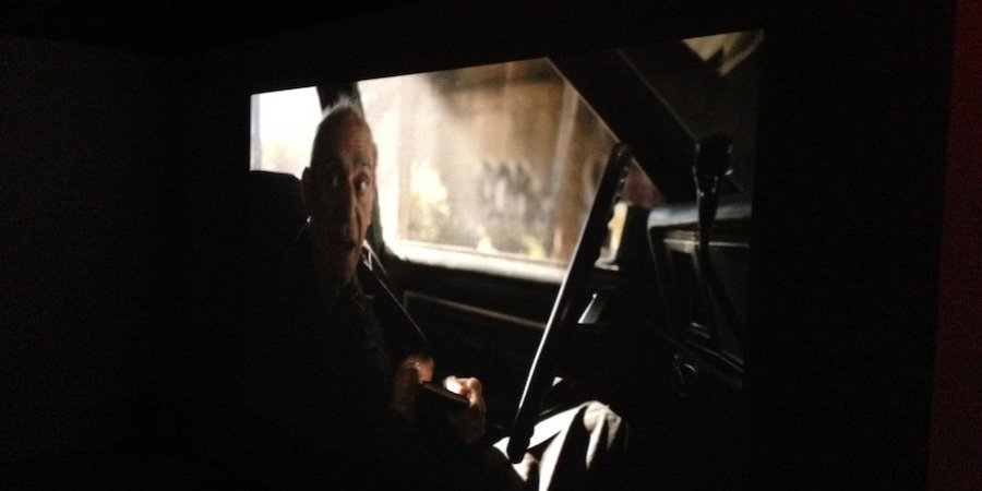 "The actor Abe Vigoda in a scene from <em>Cutaways</em>, Kurant's film at SculptureCenter bringing to life characters who were cut from the movies ""The Conversation,"" ""Vanishing Point,"" and ""Pulp Fiction"""