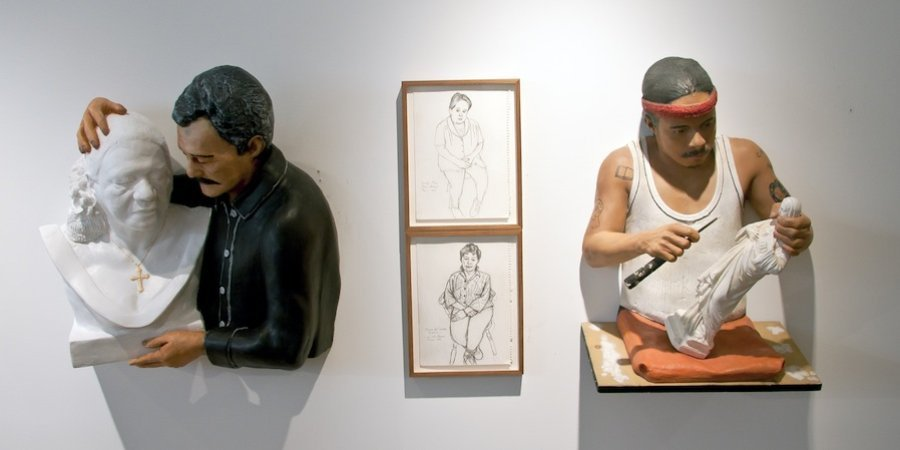 Works by Rigoberto Torres 1985 depicting workers in his uncles statuary factory