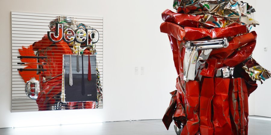 """Crow,"" 2011, Metal fixtures; car taillight; plastic sign; acrylic and mixed media on canvas on acrylic mirrored MDF slatwall with aluminum edging. (Posing with a John Chamberlain.)"