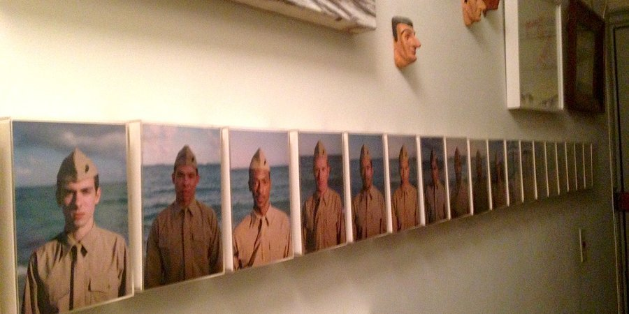 "Joe Ovelman's ""Marine Corps Uniform, 1970,"" alongside Eric Doeringer's head sculptures in the style of Maurizio Cattelan"