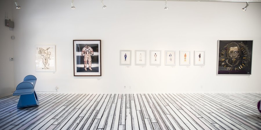 From left to right: 'Flowers,' by Donald Baechler, Albert Watson's Alan Shepard's 'Lunar Suit, Apollo 14, NASA, 1990.' Far right: 'Pele' by Ann Carington.