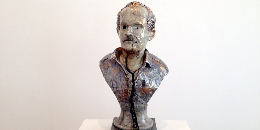 The marbles are leaking out the bottom of this cracked bust, a self-portrait of the artist, Robert Arneson, at David Zwirner.