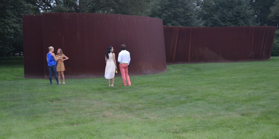 "Attendees at the Guild Hall gala admired the Richard Serra ""Torqued Ellipse"" standing on the lawn outside Leonard Riggio's Bridgehampton home."