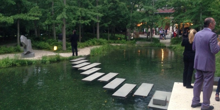 Beyond the pool, a meditative water garden holds several prime examples of Isamu Noguchi's sculpture.
