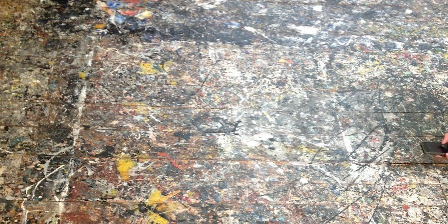 "It is possible to see the outlines of the canvases the artist taped to the floor before covering them with his celebrated ""all-over"" compositions."
