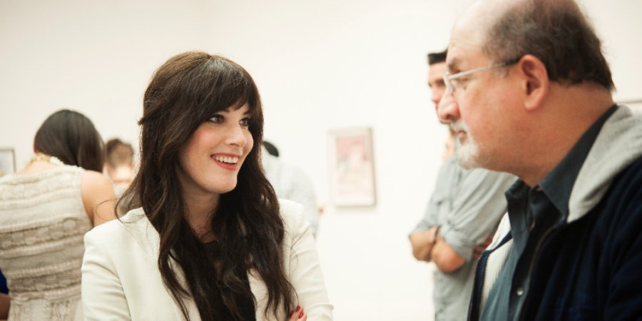 "Melissa Carroll chatting with Salman Rushdie at the opening of her new show, ""Recurrence,"" at Andrea Rosen 2. Photo by Ashley Woo Photography."
