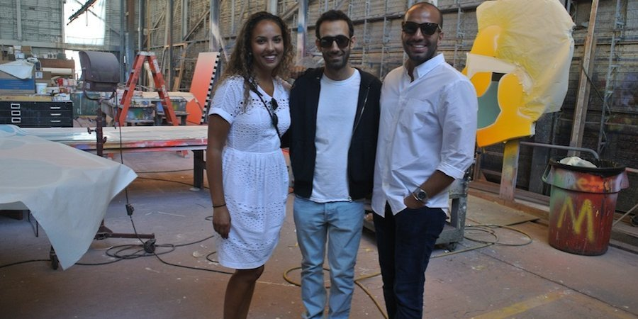 Alia Al-Senussi, artist Alex Israel, and Abdullah AlTurki in Israel's studio at Warner Bros.