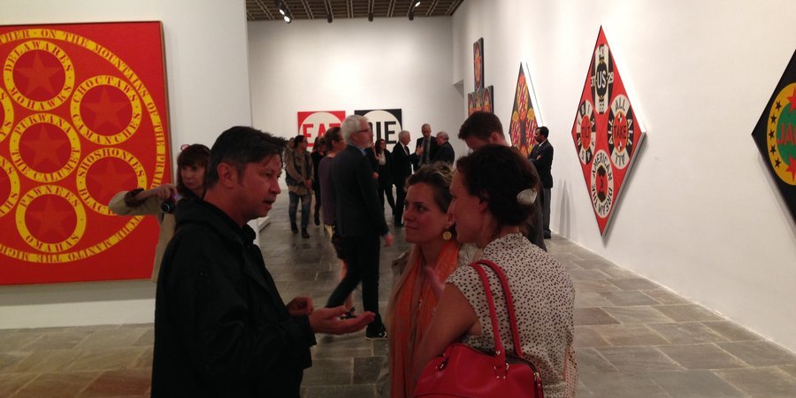 Art journalists Paul Laster, Katya Kazakina, and a friend talking at the opening