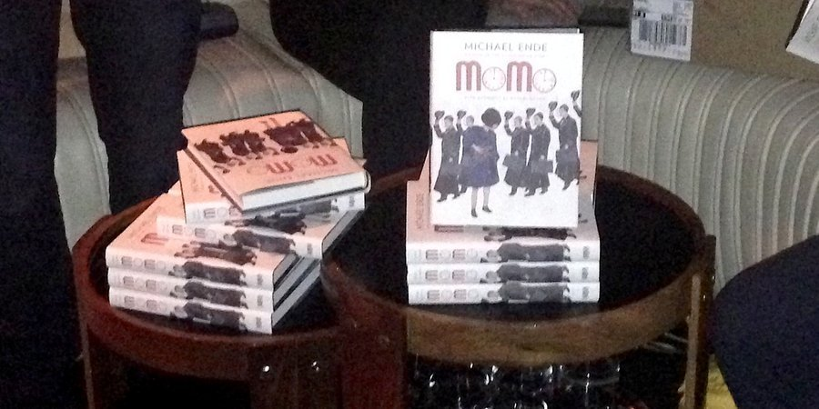 "Stacks of Michael Ende's book ""Momo,"" which is being released in the U.S. for the first time with drawings by Marcel Dzama and a translation by Lucas Zwirner, on display at the launch party at No. 8"