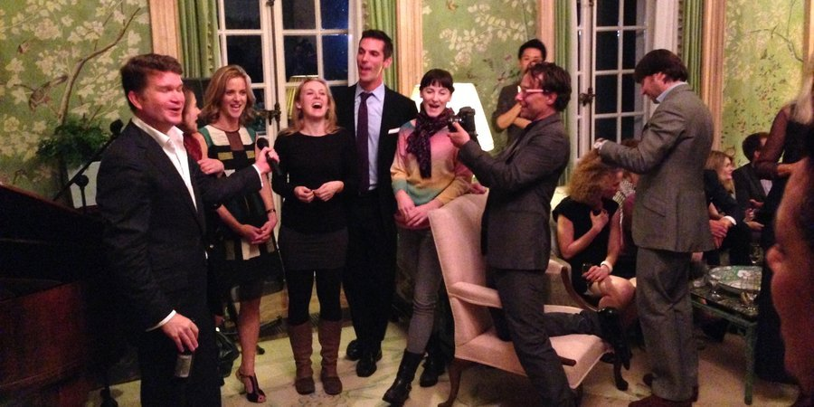 "A party at the American ambassador's residence for Jonah Freeman and Justin Lowe, from left: the American ambassador to Britain singing ""Edelweiss"" with the three granddaughters of Captain Von Trapp"