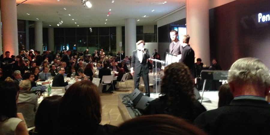 Auctioneer C.K. Swett at the Aperture benefit auction, done in partnership with Artspace