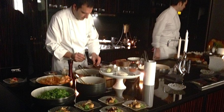 A chef prepares tastings at the Park Hyatt's launch of the new contemporary art magazine ARTPHAIRE