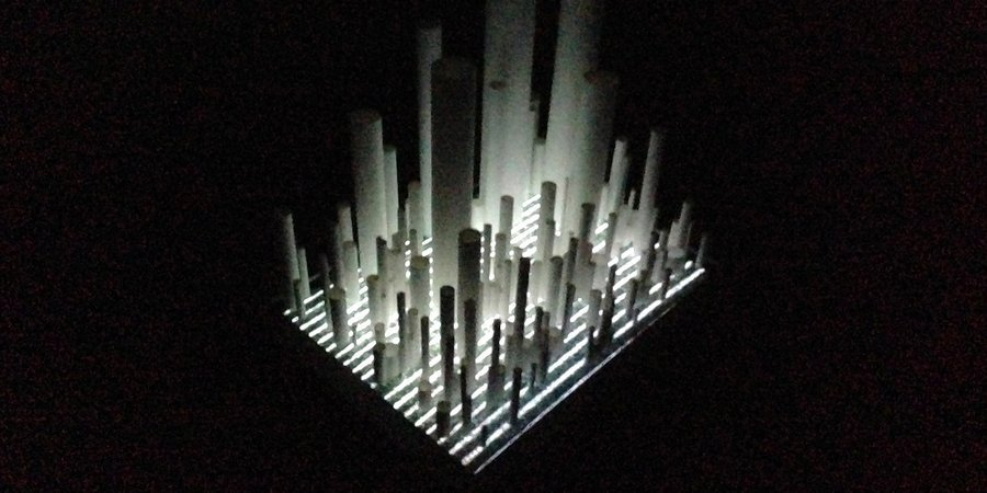 Another piece by Tichy placing paper tubes atop a flat-screen TV