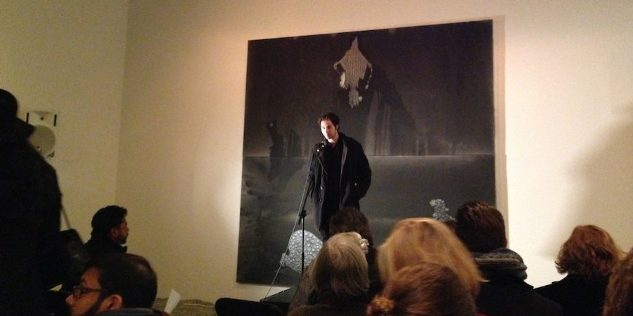 The painter and poet Stefan Bondell MCing a poetry reading he held amidst his show of new paintings at the Hole gallery.