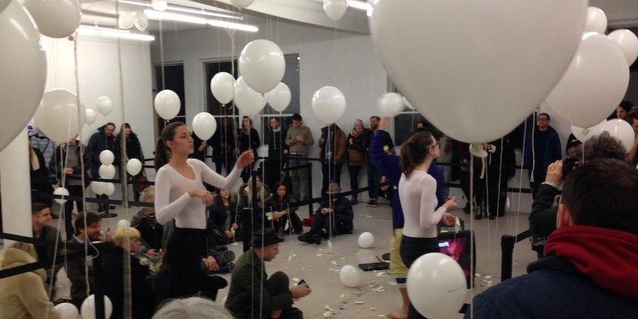 The end of the performance, with scissored balloon carcasses strewn everywhere