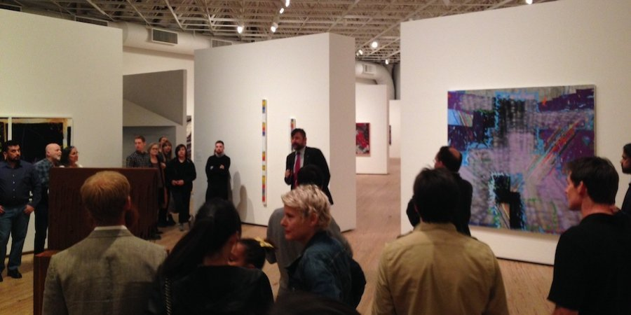 "Contemporary Art Museum Houston director Bill Arning addressing the crowd at the opening of ""Outside the Lines,"" a new survey of recent painting"
