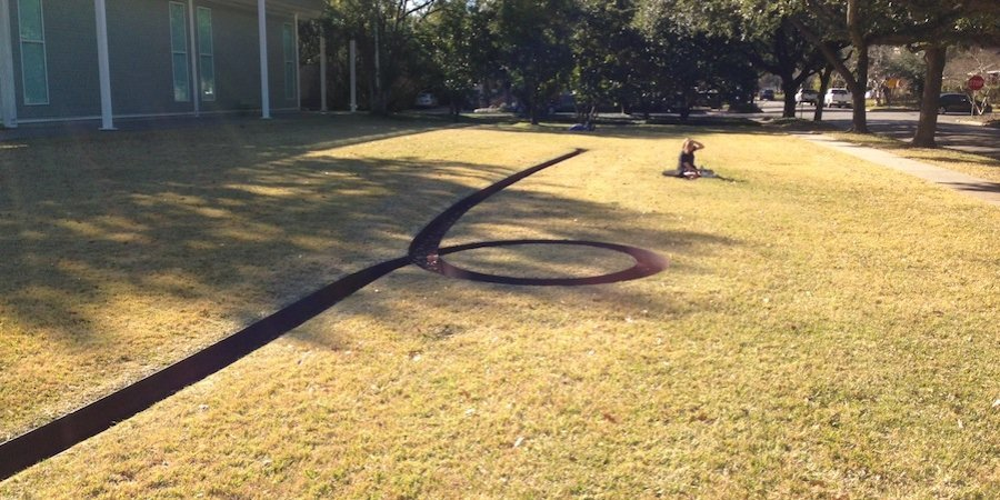 A Michael Heizer earthwork confronts visitors outside the Menil