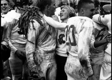 Burt Glinn - USA. Seattle, Washington. 1955. The head cheerleader and the football captain embrace after a game. Their team had just won a game for the first time in three years.