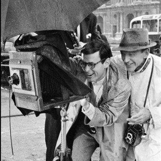 Paris. The Tuileries Gardens. Richard Avedon, fashion photographer and technical director, advising Fred Astaire on his role as a photographer. art for sale