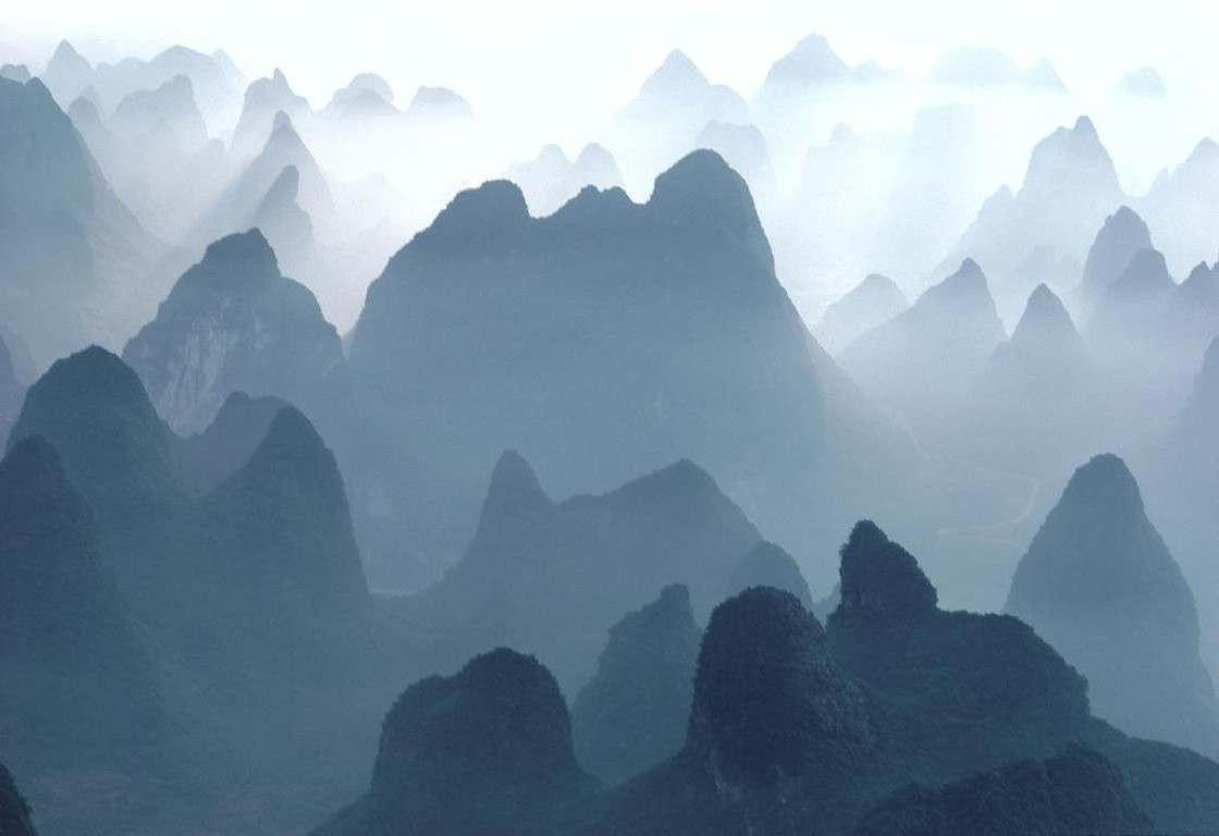 main work - Hiroji Kubota, China. Guilin. Huangshan Mountains. 1980. Aerial view of Li River and Mountains.