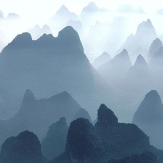 Hiroji Kubota, China. Guilin. Huangshan Mountains. 1980. Aerial view of Li River and Mountains.