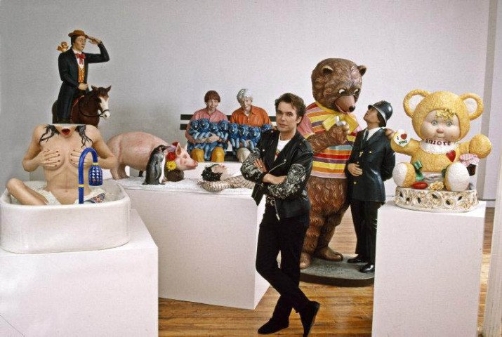 by thomas_hoepker -  1989. Jeff Koons with collection of his sculptures in New York.
